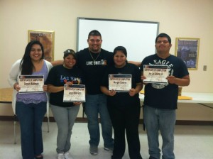 Students Receiving Certificates at Lopez